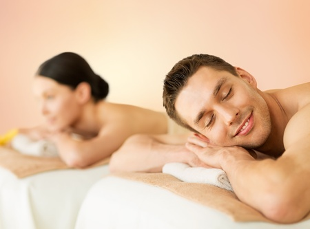closed eye: picture of couple in spa salon lying on the massage desks