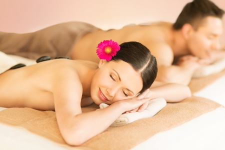 couples therapy: picture of couple in spa salon with hot stones