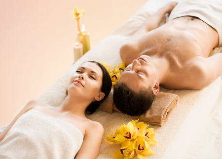 picture of couple in spa salon lying on the massage desks Stock Photo - 20605864