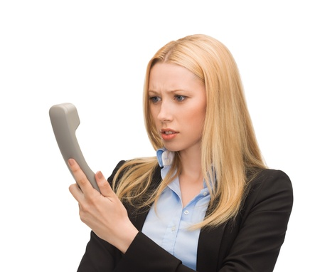 bright picture of confused woman with phone Stock Photo - 20611798