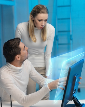 lab tech: futuristic man and woman working with virtual screen Stock Photo