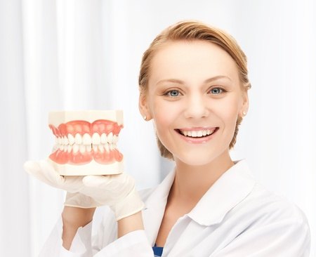 stomatologist: picture of attractive female doctor with big jaws..