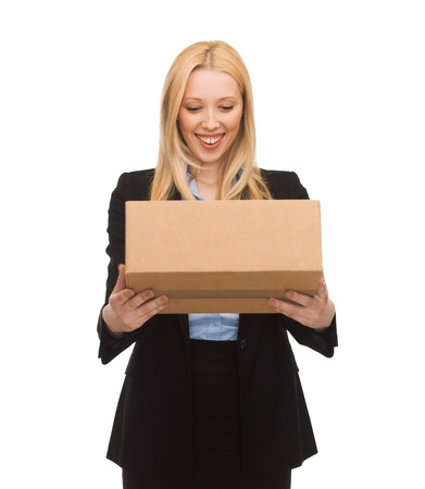 order shipment: picture of attractive businesswoman delivering cardboard box