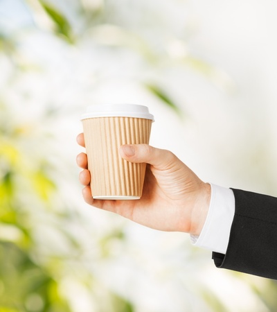 man hand holding take away coffee cup Stock Photo - 20557544