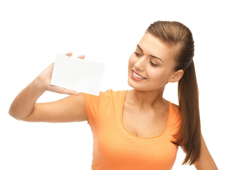 picture of smiling woman holding white blank card Stock Photo