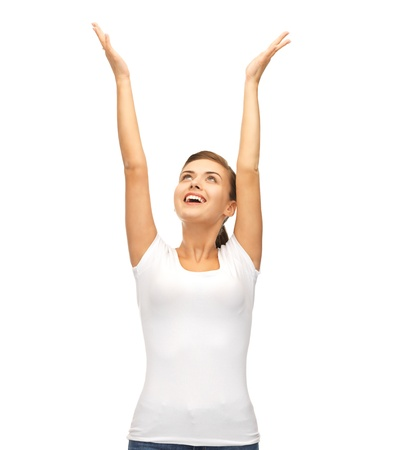 picture of young happy woman with hands up photo