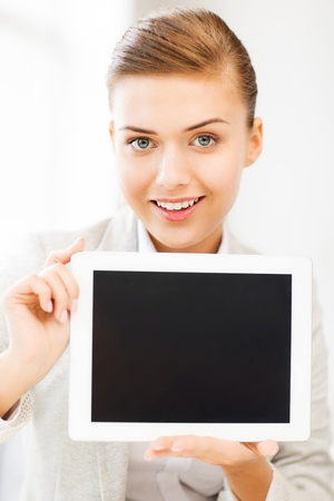 picture of smiling businesswoman with tablet pc in office Stock Photo - 20613752
