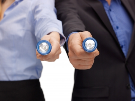 corporate espionage: picture of business team holding pocket flashlights Stock Photo
