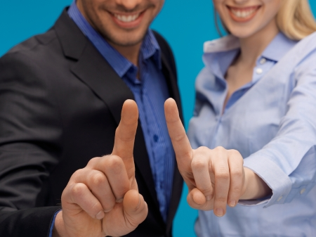picture of man and woman hands pointing at something photo
