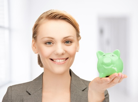 picture of lovely woman with small piggy bank photo