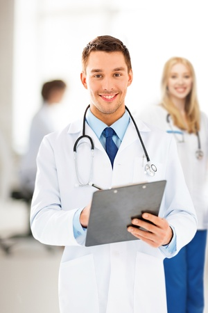 bright picture of male doctor writing prescription photo