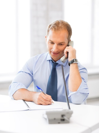 picture of handsome businessman talking on the phone photo