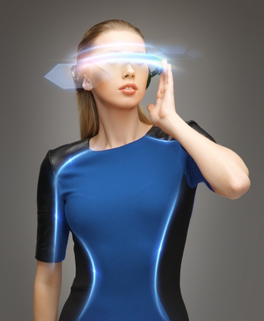 cyber woman: beautiful woman in futuristic glasses and blue dress