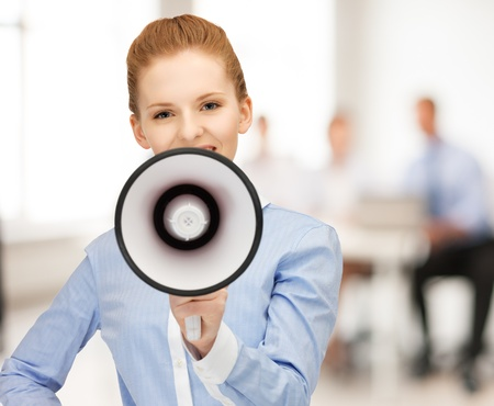 loudhailer: close up of friendly businesswoman with megaphone in office Stock Photo