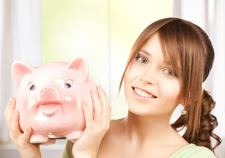 picture of lovely girl with big piggy bank photo