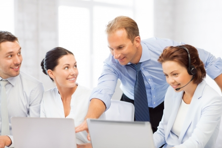 team leader: picture of group of people working in call center or office