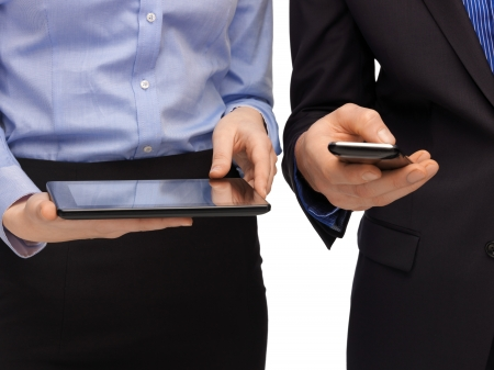 woman and man hands with smartphone and tablet pc photo