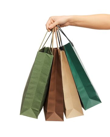 shopaholics: close up of woman hands holding shopping bags