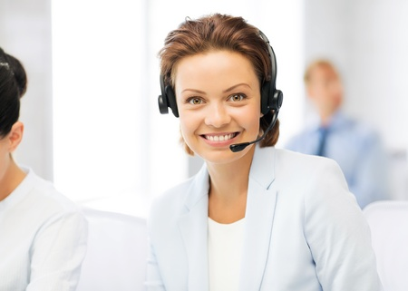 the secretary: picture of friendly female helpline operator with headphones