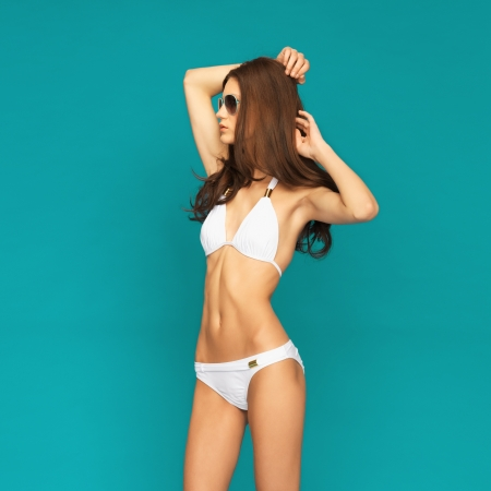 picture of model posing in white bikini with shades