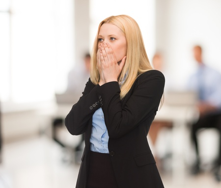 stressed woman holding her head with hand in office Stock Photo - 20595338
