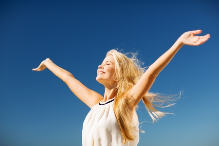 happiness: lifestyle concept - beautiful happy woman enjoying summer outdoors Stock Photo