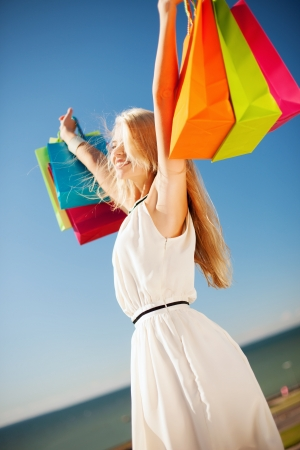 shopping and tourism concept - woman with shopping bags Stock Photo - 20595306