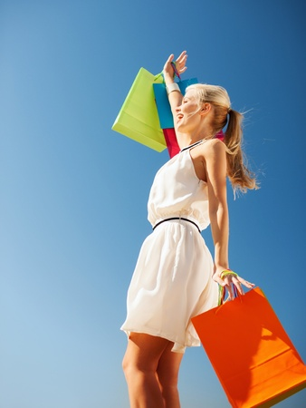 shopping and tourism concept - woman with shopping bags Stock Photo - 20595424