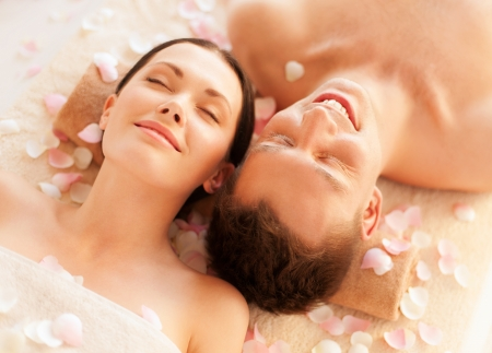 facial  spa: picture of couple in spa salon lying on the massage desks