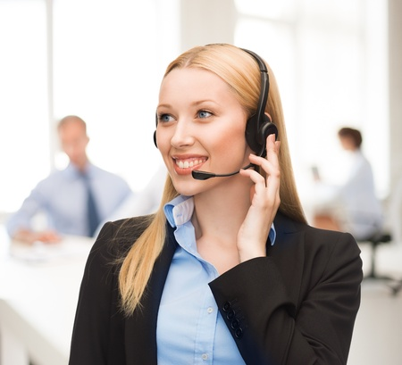 friendly helpline operator with headphones in call centre photo