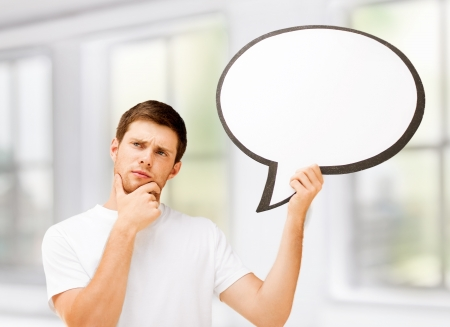free thought: picture of thinking young man with blank text bubble