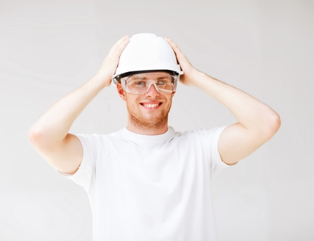 picture of male architect in helmet with safety glasses photo