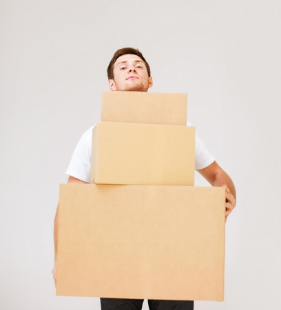 accomodation: picture of young man carrying carton boxes Stock Photo