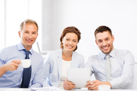 co work: happy business team having fun with tablet pc in office Stock Photo