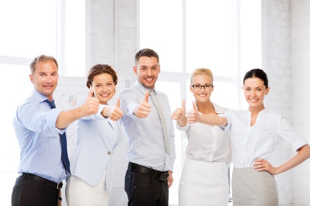 enthusiastic: picture of happy business team showing thumbs up in office Stock Photo