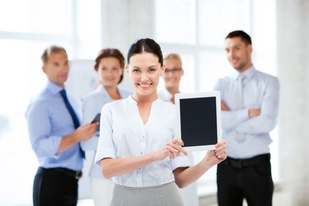 picture of smiling businesswoman with tablet pc in office Stock Photo - 20671913