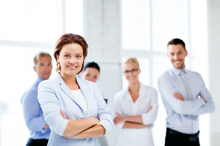 group business: picture of smiling attractive businesswoman in office Stock Photo