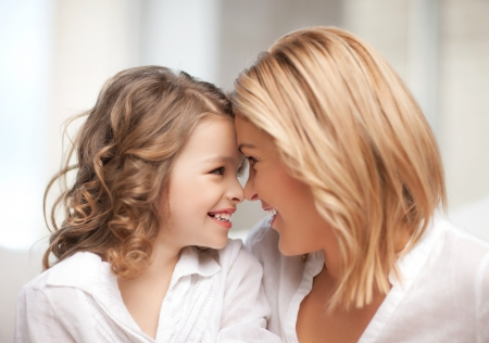 pre adult: bright picture of mother and daughter cuddling