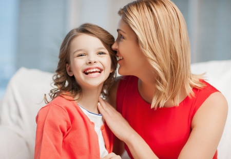 bright picture of mother and daughter cuddling photo