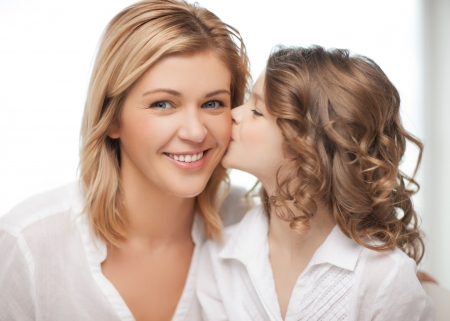 pre adult: happy family - daughter kisses her mother