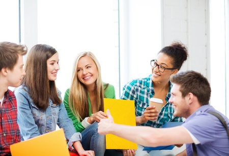 university classroom: education concept - students communicating and laughing at school