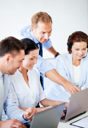 picture of group of people working in call center or office photo