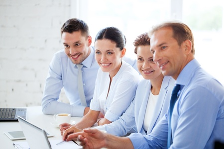 friendly business team having meeting in office Stock Photo