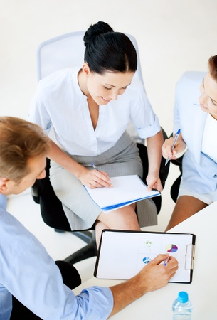 accountancy: friendly business team having discussion in office