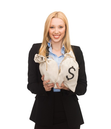 young businesswoman holding money bags with dollars photo