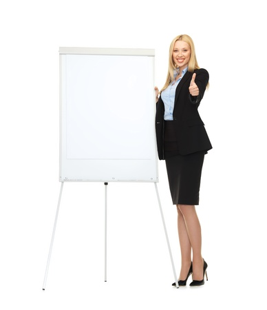 briefing: picture of smiling businesswoman with white blank flipchart Stock Photo
