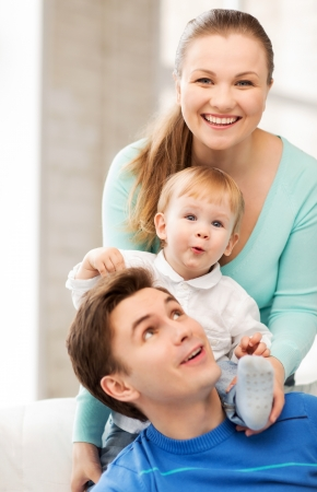 picture of happy parents playing with adorable baby photo