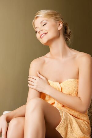 wellness center: picture of happy woman sitting in spa