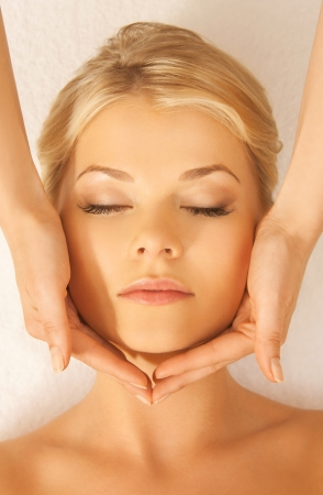 facial treatment: close up of woman in spa salon getting face treatment