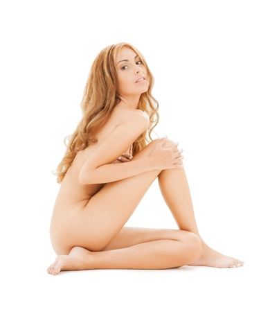 naked woman sitting: picture of attractive naked woman with long hair sitting on the floor